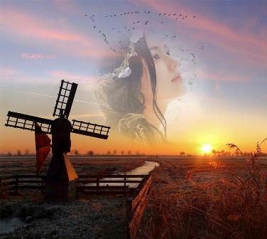 Un fotomontaje en un paisaje hermoso con un molino de viento con el ...